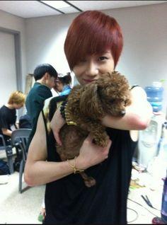 Taemin holding EXO's Kai's dog. merrrh :) Taemie cuddling his BFF Kai's puppy awee