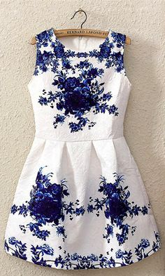 Flattering syle; White and blue porcelain floral dress..a little longer and it would be perfect for me.