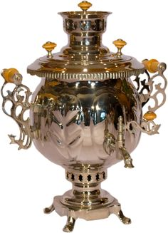 elegant russian samovar. i don't know, the enameled ones are more homey, and i think i like them better.