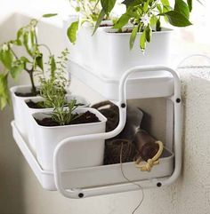 Indoor/outdoor planters, like the Socker Plant Stand ($40) and pot with holder ($25), make it easy to infuse your apartment with lively greens.