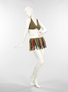 """1965 wool bathing suit by Rudi Gernreich was an experimental design.  The tan knit bathing suit with its multi-color fringe skirt is characteristic of the """"Youthquake Movement"""" of the 1960s."""