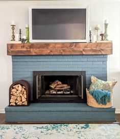 This fireplace used to be an eyesore until it's DIY fireplace makeover. We painted the brick and fireplace doors, built the DIY mantel and TV frame, and added some inexpensive accessories. And now it's the fireplace we always wanted. Rustic Fireplace Mantels, Diy Mantel, Painted Brick Fireplaces, Fireplace Doors, Paint Fireplace, Brick Fireplace Makeover, Wood Mantels, Home Fireplace, Fireplace Surrounds