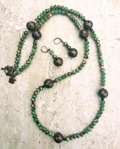 Green crystals with electroplated copper accents strung in chunky copper filigree beads make this necklace earrings set a wonderful gift for her! Ships Free.