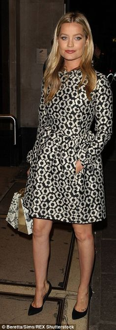 Glamorous girls: Laura Whitmore looked stunning in a floral-print trench coat...