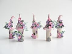 Miniature fairy village in pale pink, lilac and grey handmade from polymer clay. $38.00, via Etsy.