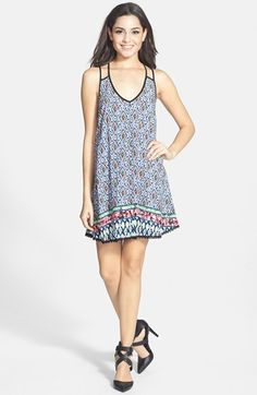 Free shipping and returns on En Crème Strappy Trapeze Dress (Juniors) at Nordstrom.com. Bright, geometric patterns play over a swingy trapeze dress styled with split spaghetti straps and a pretty V-neckline.