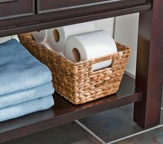 Store extra toilet paper in a pretty basket