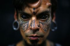 A man poses for a portrait at Caracas's International Tattoo Festival