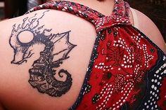 Sea horse tattoo.