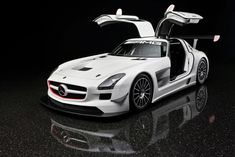 What happens when you take a Mercedes SLS AMG, strip out the superfluous baloney, amp-up the engine and install race seats, gauges and gear? You get this — the factory-built Mercedes SLS AMG racer. Mercedes Benz Amg, Mercedes Auto, Custom Mercedes, Mclaren Mercedes, Mclaren P1, Porsche, Luxury Sports Cars, Sport Cars, Race Cars