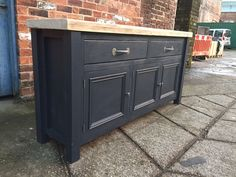 This is our painted Skaker style sideboard with reclaimed wood top.  The sideboard is a 2 drawer over 3 cupboard design, and measures 160cm wide x 44cm deep x 78cm tall.  The top is made from reclaimed wood and has been left full of charachter - it can be stained to any colour.  The base is finished in Farrow & Ball Railings, but again can be finished in any colour.  The unit has cast iron pull handles on the drawers and cupboards.  We make all the furniture to order so we can make this t...