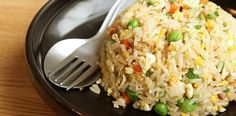 simple fried rice on black plate