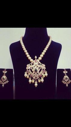 Pearls with diamond pendant