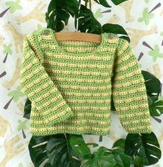 Great for little girls and boys, this Striped Baby Sweater is a great way to keep warm during the cooler fall and winter months.  Available in a variety of sizes, this crocheted sweater can be made for babies as young as 6 months to as old as a year.