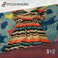 Juniors medium cute striped dress Juniors medium striped dress. Gathered at the waist to look more flattering. The colors of the stripes are tan, orange, dark blue, blue, teal and white. Beautiful flowing style. Has an attached slip also. Dresses Midi