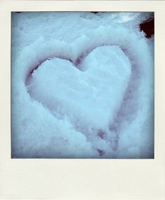 for engagement pics - couple standing inside of snow heart <3