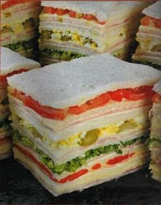 Sandwich de miga - Assorted, thin bread sandwiches in Argentina. Delicious for a snack or cocktail. Argentine Recipes, Chilean Recipes, Argentina Food, Great Recipes, Favorite Recipes, Good Food, Yummy Food, Tea Sandwiches, High Tea