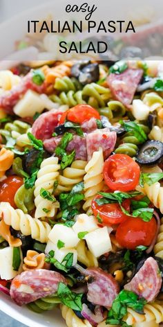 Italian Pasta Salad is always a winner with tri-color rotini pasta loaded with sliced cherry tomatoes, fresh basil, black olives, quartered salami, and diced mozzarella cheese. It's so versatile and always a crowd favorite! recipes for dinner Clean Eating Snacks, Healthy Eating, Pasta Salat, Pasta Salad Italian, Olive Salad Recipe Italian, Italian Chopped Salad, Cooking Recipes, Healthy Recipes, Easy Potluck Recipes