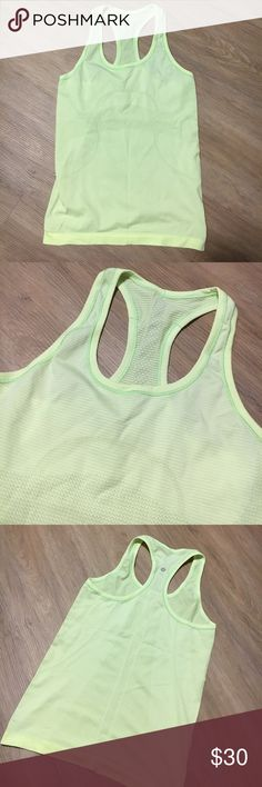 Lululemon Racerback, 6 Lupulemon racerback tank. Size 6. In excellent 9/10 condition. No stains. One small snag on back, no pulling or tears. Color is a highlighter yellow/green. Perfect for working out or warm summer days!!! lululemon athletica Tops Tank Tops