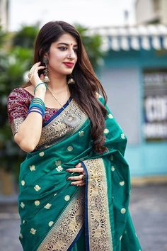 This Saree is Ready to Wear (With Fall and Pico Done). A designer saree in Teal Green Color. It has intricate design all over the saree. This saree is a suitable amalgamation of style and grace that is required from an ethnic wear. The saree is ideal for any formal gathering. The saree comes with an unstitched blouse of corresponding color and design as shown in the picture. Banarasi Silk Designer Teal Green Color Saree Fabric Type: Banarasi Art-Silk Primary Colour: Teal Green Secondary… Secondary Color, Primary Colors, Teal Green Color, Green Saree, Bowl Designs, Black Thread, Bangle Set, Style And Grace, Baby Size