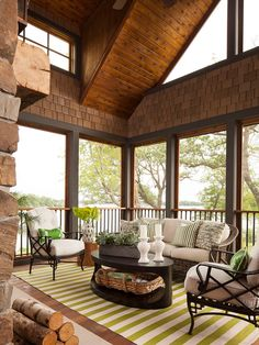 Lake Home Gorgeous Covered Porch with charming seating area by  Martha O'Hara Interiors