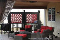 red privacy attice panel make for colorful privacy screens. Interesting design too.  On PorchIdeas.com #decks