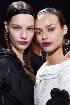 This is what every single fall beauty trend looks like at once, as seen on the H&M Studio runway. There was slick hair, a strong part, braids, and a black leather headband, plus glowing skin and a pop of purple-pink lipstick. Makeup artist Mark Carrasquillo combined L.A. Girls Lipsticks in Manic and Love Triangle together to get this particular shade, then mattified the lip further with a touch of blush. The shade looked universally fun and fitting on models of every skin tone, which is ...