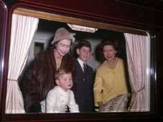 Queen Elizabeth. Princess Margaret, Prince Charles and either Prince Andrew or Prince Edward.