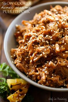 Slow Cooker Honey Sesame Pulled Pork - This meal is SO delicious, easy and PERFECT for a busy day!