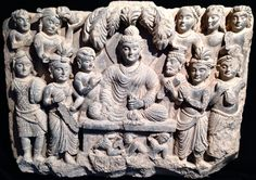 BUDDHA'S DEFEAT OF THE DEMON MARA. Gandhara, 1st-2nd century AD. 24 x 18 inches. A beautiful stele of the seated Buddha surrounded by attendants and devotees having defeated the demon Mara