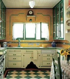 Cute cabinets and nice green trim