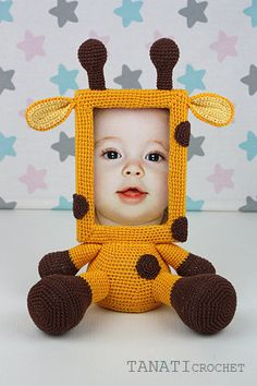 This is a crochet pattern (PDF file) NOT a finished Photo Frame you see on the photos! This pattern is available in: English German Russian SKILL LEVEL: INTERMEDIATE Photo Frame GIRAFFE – size 30 cm (12 in), if using fingering weight yarn (14 wpi, YarnArtBegonia). Material: • yarn • hook 2.5 mm • glue gun • soft stuffing • scissors • Photo Frame 10x15 (frame width of 1.5 cm, thickness 1 cm) • cardboard • needle for sewing Pattern exists only in electronic form. The PDF file contains 12 pa...