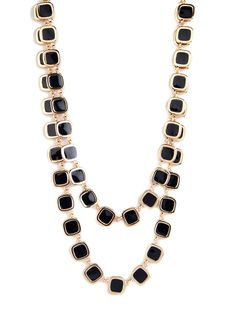 Indulge in the sophisticated classicism of this luxe statement necklace. With its gold and ebony tile accents, it's both ladylike and elegant.