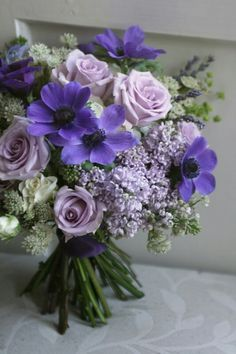 Purple Hand Tied Wedding Bouquet Featuring: Purple Anemones, Fresh Lavender, Lavender Roses, White Roses, Lilac, White Astrantia & Greenery/Foliage