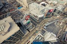 Birds eye view: Rooftoppers avoid security, CCTV and risk their lives on top of the windy ledges up to almost 1,000 feet high