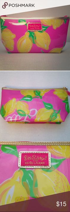 Lilly Pulitzer Cosmetic Bag New adorable bag in pink with lemons! Perfect for the summer. This is a re-posh. I got it because it is so cute, but I have too many make up bags and haven't used it. Lilly Pulitzer Bags Cosmetic Bags & Cases