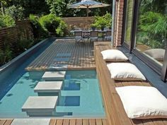 modern small swimming pool by Terramanus Nice fence design Concrete path across wood and water