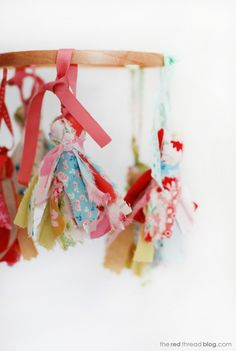 the red thread fabric tassel mobile