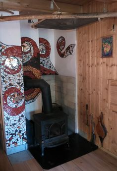 wall mosaic in the interior of the cottage inspired by the element of fire