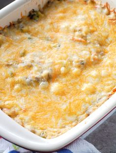 Filled with cheese, ground beef, carrots, broccoli and rice, this cheesy ground beef and rice casserole is a simple, delicious meal great for the whole family.
