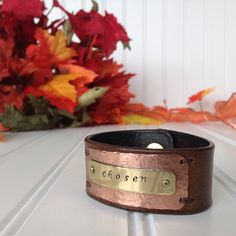 "My newest addition for Fall is the ""Riverbed"". I'm so excited about this design and all of the beautiful details put into this cuff!! It sports a copper hammered plate beneath an antique brass word plate and is finished off with premium round head rivets and hand sewn to your cuff. Riverbed is 1&1/8"" wide, and you can choose Calligraphy or Block font to customize your word plate (to order click link in bio). The Riverbed is $40 https://www.facebook.com/Catz16Designs"