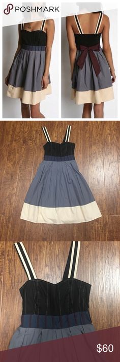"Urban outfitters Lux cotton color block dress Anthropologie lux dress. ONLY WORN ONCE!!! Light cotton dress with a striped tieback belt at the empire waist. Subtle pleating through the skirt with a colorblocked hem. Finished with smocking at the back and adjustable shoulder straps for a sure fit. Exclusive to Urban Outfitters. Imported. Machine wash. * House dress silhouette * Knee length * 26.25""l from center back to hem * Fits true to size * Cotton Urban Outfitters Dresses"