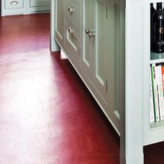 Add some oomph with a new floor made of old-school, easy-to-clean linoleum. Similar to shown: Marmoleum 13-by-13-inch tiles in Red Amaranth 