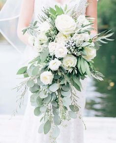Need a bridal bouquet inspiration for your wedding? Consider the white bridal bouquet. While we love scoping out all of the innovative floral designs that are out there, a white bouquet will forever be timeless. But why white? Cascading Wedding Bouquets, Vintage Wedding Flowers, Cascade Bouquet, Wedding Flower Arrangements, Bridal Flowers, Flower Bouquet Wedding, Wedding Centerpieces, Floral Wedding, Wedding Decorations