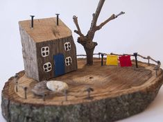 Lovely little wooden house with a tree and laundry over the walnut wood of oval shape. Wonderful home and shop decoration. Perfect gift for any occasion. Suitable gift for men and women. Handmade to make you happy. We are here to answer all your questions. Thank you for visiting our