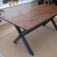 Upcycled door dining table : handmade reclaimed furniture : wooden cross-leg frame handmade to measure and painted in a stylish dark grey, with a durable matt varnish finish.
