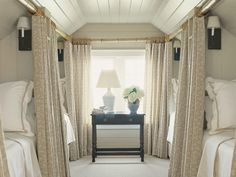 I love that an attic room can be converted into a bunkhouse, but with the feel of train sleeper cars thanks to the privacy curtains.