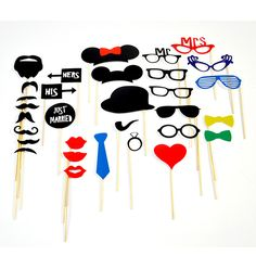 Our His & Hers Photo Booth Props are the perfect addition to your next wedding photo shoot. This set features a large assortment of photo booth props, including 8 glasses, 8 mustaches, 3 hats, 3 lips, 3 signs, 2 bow-ties,1 heart,1 cigar, 1 ring and 1 tie.