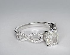 Stunning diamond engagement ring with infinity style band  www.lafia.ca