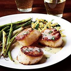 Sear scallops in a cast-iron skillet and top with a savory pan sauce of butter, white wine and herbs. Serve with Roasted Green Beans...